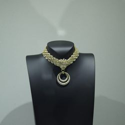 Richard Burton gave this fancy necklace to Elizabeth Taylor when she became a grandmother.