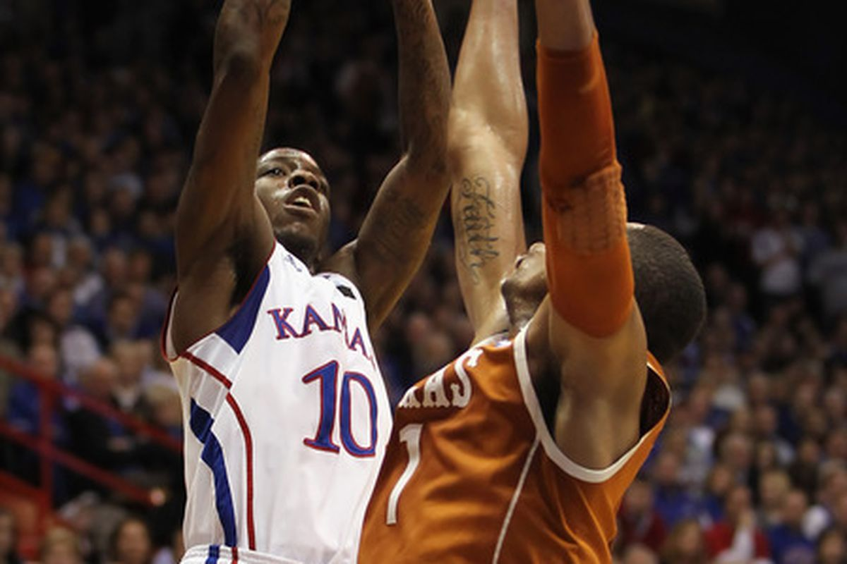 LAWRENCE KS - JANUARY 22:  Tyshawn Taylor #10 of the Kansas Jayhawks shoots over Gary Johnson #1 of the Texas Longhorns during the game on January 22 2011 at Allen Fieldhouse in Lawrence Kansas.  (Photo by Jamie Squire/Getty Images)