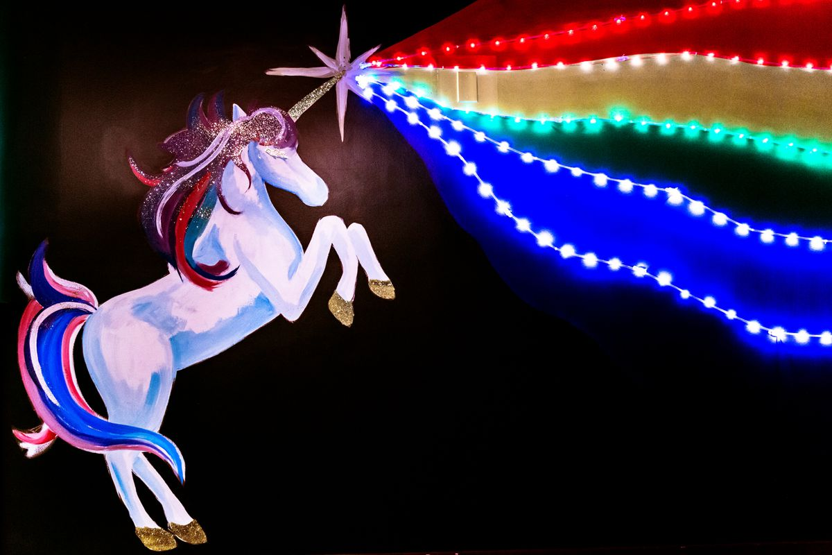 mural of unicorn with rainbow coming out of its horn