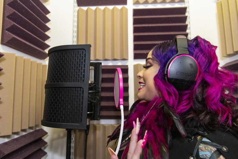 Hip-hop artist Pinqy Ring rhymes a few verses in her home recording booth in Logan Square.