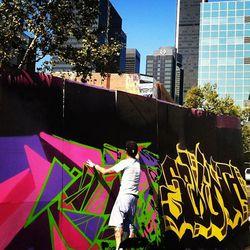 "Street artist Ironlak gracing the fest's main wall [Photo via <a href=""http://instagram.com/p/Pn8-mhq7yU/"">Meowcatciao</a>]"