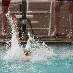 A swimmer competes at the 6A girls swim championship at Kearns Oquirrh Park Fitness Center in Kearns on Saturday, Feb. 20, 2021.