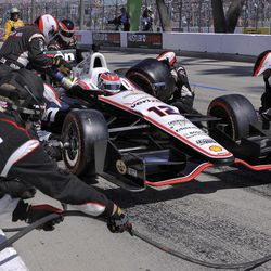 Will Power, of Australia, makes a pit stop during the IndyCar Series' Toyota Grand Prix of Long Beach auto race, Sunday, April 15, 2012, in Long Beach, Calif.  Power won the race.
