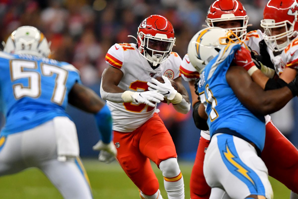 Darrel Williams #31 of the Kansas City Chiefs runs the ball while Jatavis Brown #57 of the Los Angeles Chargers bears down during an NFL football game on Monday, November 18, 2019, in Mexico City. The Chiefs defeated the Chargers 24-17.