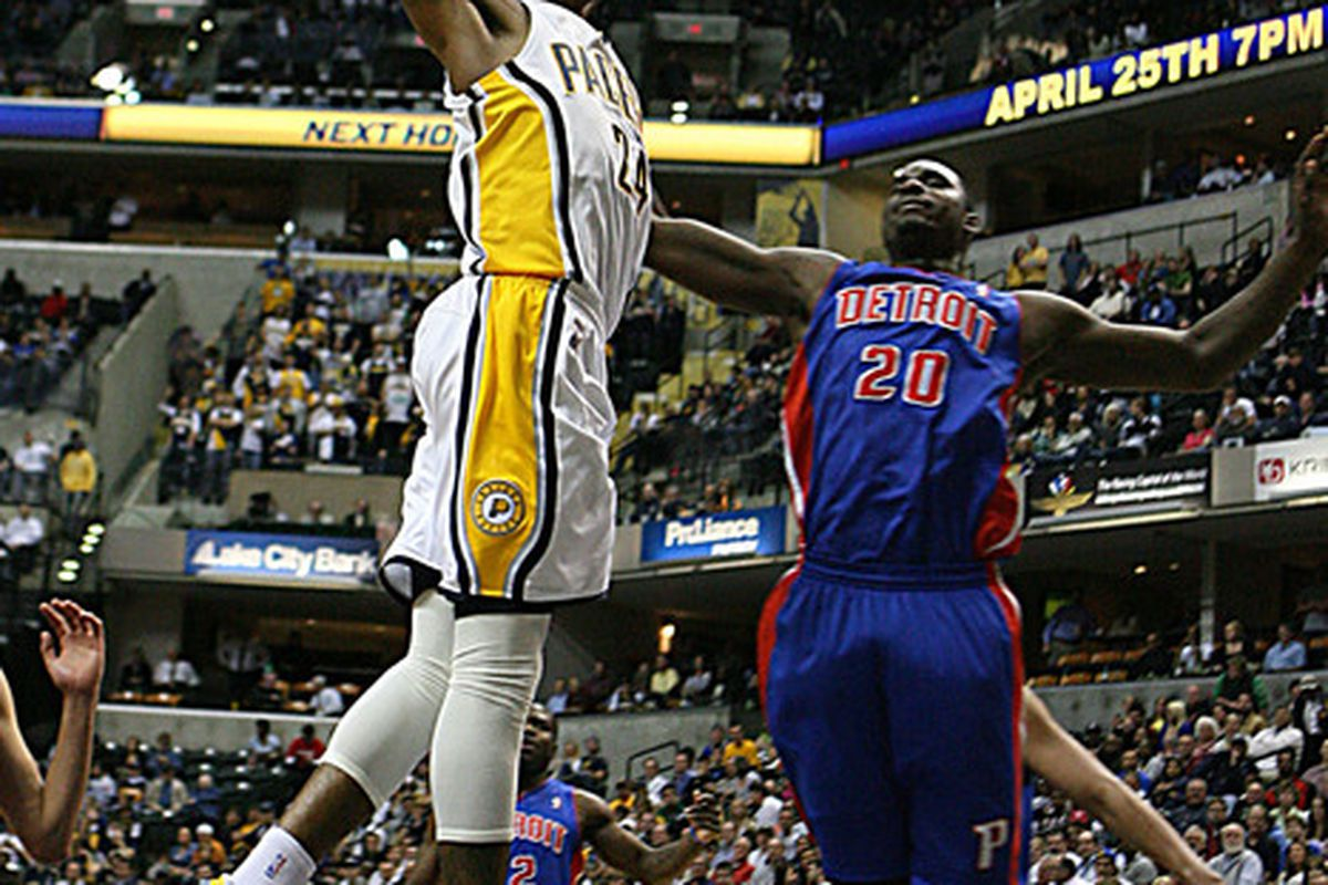 Apr 23, 2012; Indianapolis, IN, USA; Indiana Pacers forward Paul George (24) dunks against Detroit Pistons forward Vernon Macklin (20) at Bankers Life Fieldhouse. Indiana defeats Detroit 103-97.  Mandatory Credit: Brian Spurlock-US PRESSWIRE
