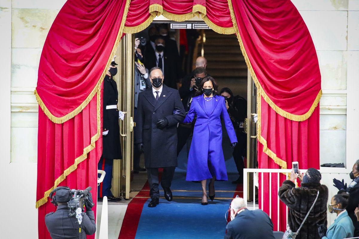 Vice President Kamala Harris with her husband, Doug Emhoff, arrive at the inauguration ceremony.