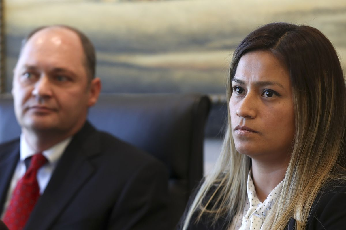 Immigration attorney Ysabel Lonazco, right, and attorney Dustin Lance talk about a case where their clients Robert Arias and his wife, Phawell Arias, are suing Dr. Paul Wade Wyatt, his wife, Marni Wyatt, Wyatt Eye and others, for traumatic injuries that they say Arias sustained to his right eye resulting in blindness, and the loss of his eye. Lance talked to the media from his offices in Salt Lake City on Monday, Oct. 14, 2019.