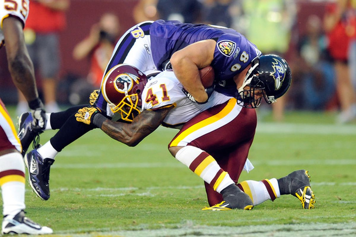 LANDOVER MD - AUGUST 21:  Kareem Moore #41 of the Washington Redskins makes a tackle during the preseason game against Todd Heap #86 of the Baltimore Ravens at FedExField on August 21 2010 in Landover Maryland.  (Photo by Greg Fiume/Getty Images)