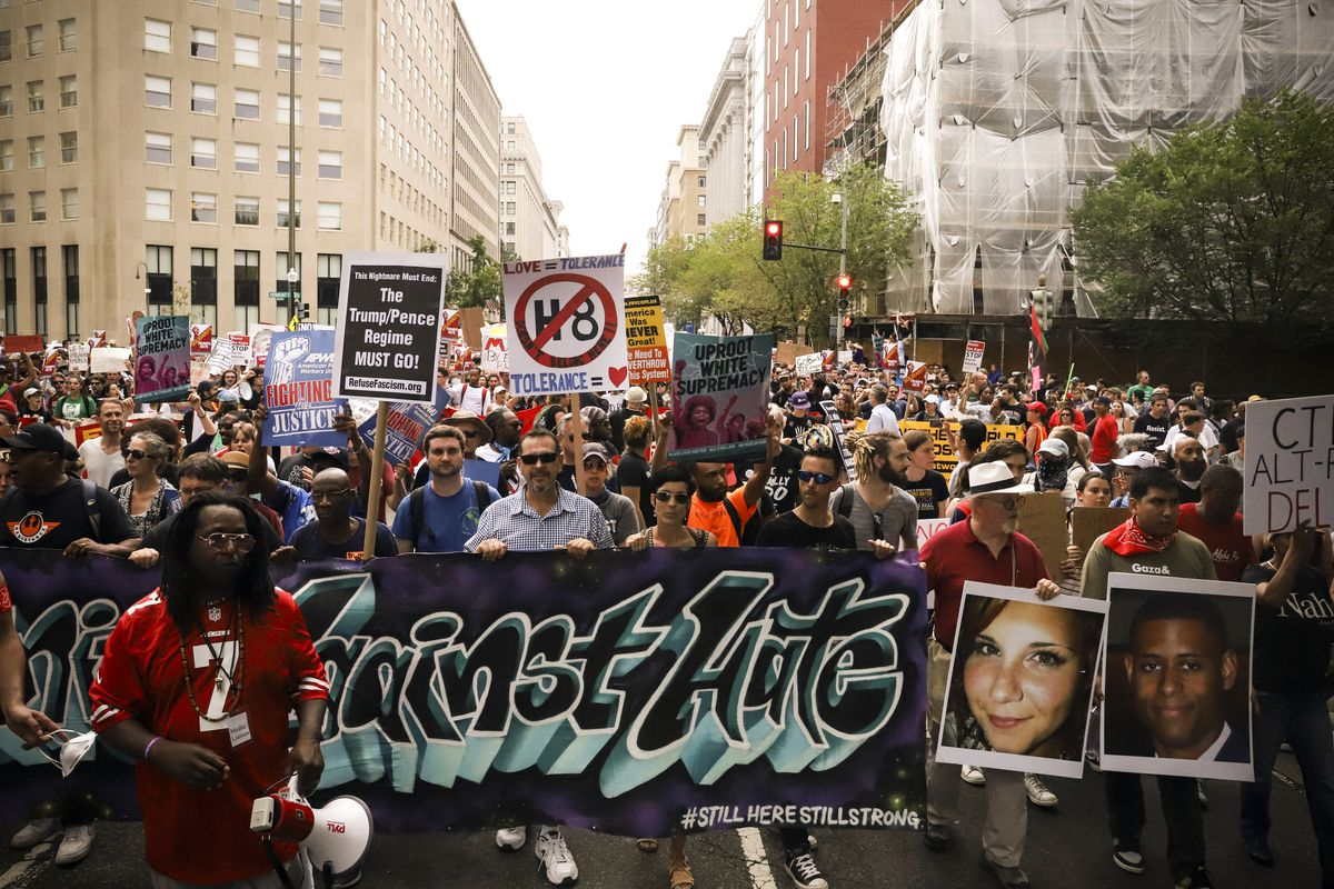 Counter-protesters march from Freedom Plaza to Lafayette Park before the Unite the Right 2 rally.