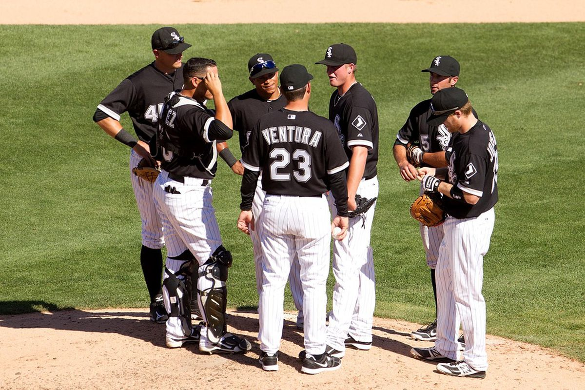 Mar 22, 2012; Glendale, AZ, USA; Chicago White Sox manager Robin Ventura (23) speaks with his team during the seventh inning against the Kansas City Royals at The Ballpark at Camelback Ranch. Mandatory Credit: Allan Henry-US PRESSWIRE