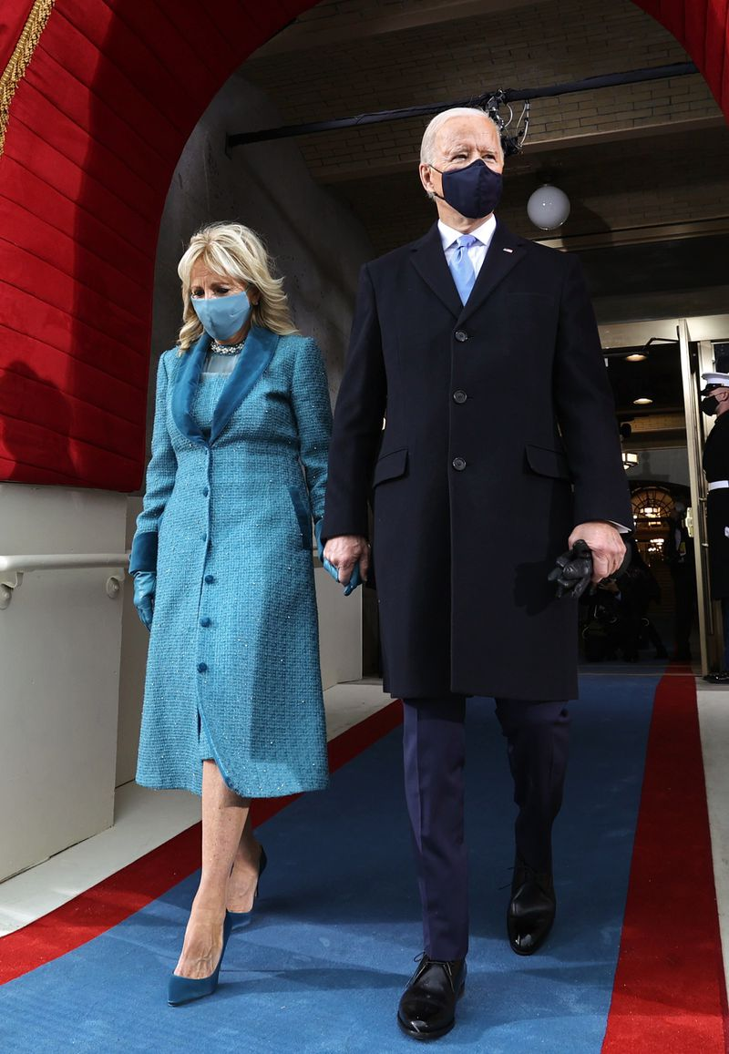 President-elect Joe Biden arrives with his wife Dr. Jill Biden for his inauguration on the West Front of the U.S. Capitol.