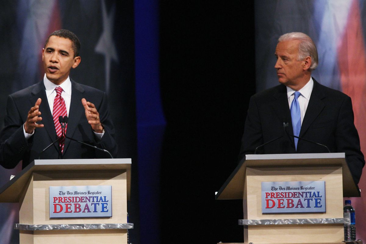 Barack Obama and Joe Biden behind podiums  at the Democratic presidential primary in 2007.