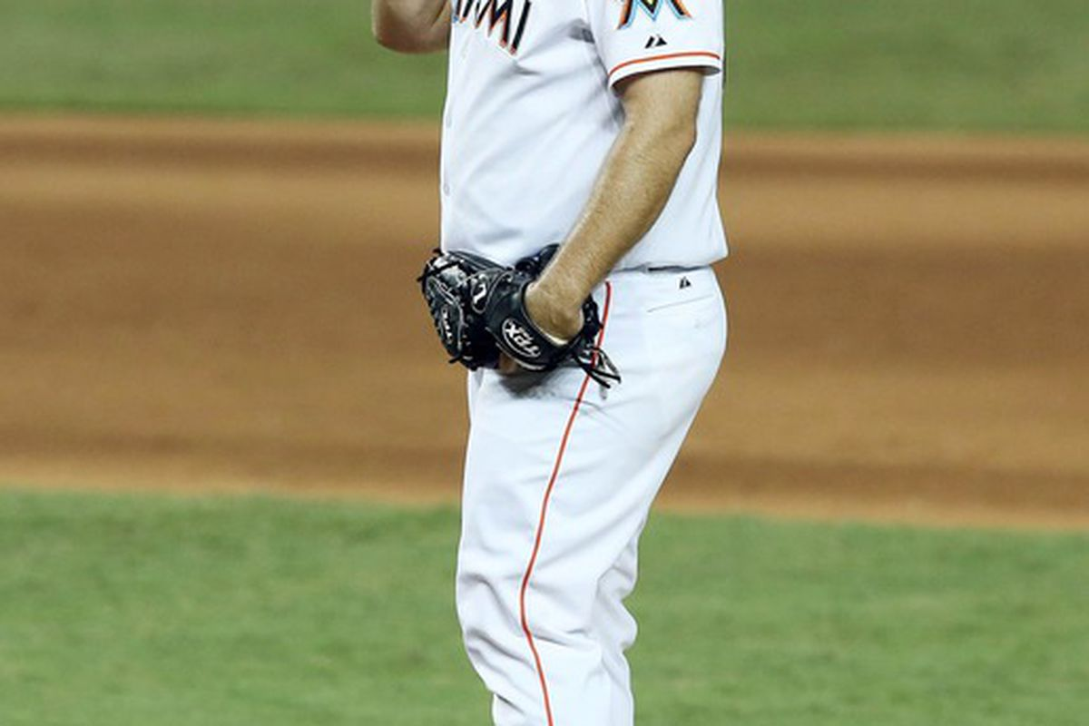 May 26, 2012; Miami, FL, USA;  Miami Marlins relief pitcher Heath Bell (21) reacts in the ninth inning against the Miami Marlins at Marlins Park. The Marlins defeated the Giants 5-3. Mandatory Credit: Robert Mayer-US PRESSWIRE