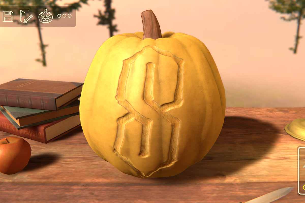 A yellow-ish pumpkin with a cool S carved into it