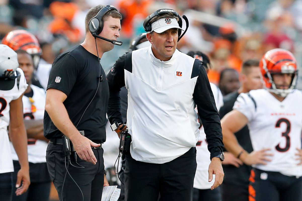 Cincinnati Bengals head coach Zac Taylor talks with defensive coordinator Lou Anarumo in the fourth quarter of the NFL Preseason Week 3 game between the Cincinnati Bengals and the Miami Dolphins at Paul Brown Stadium in downtown Cincinnati on Sunday, Aug. 29, 2021. The Dolphins made a long touchdown drive in the fourth quarter to win 29-26. Miami Dolphins At Cincinnati Bengals Preseason