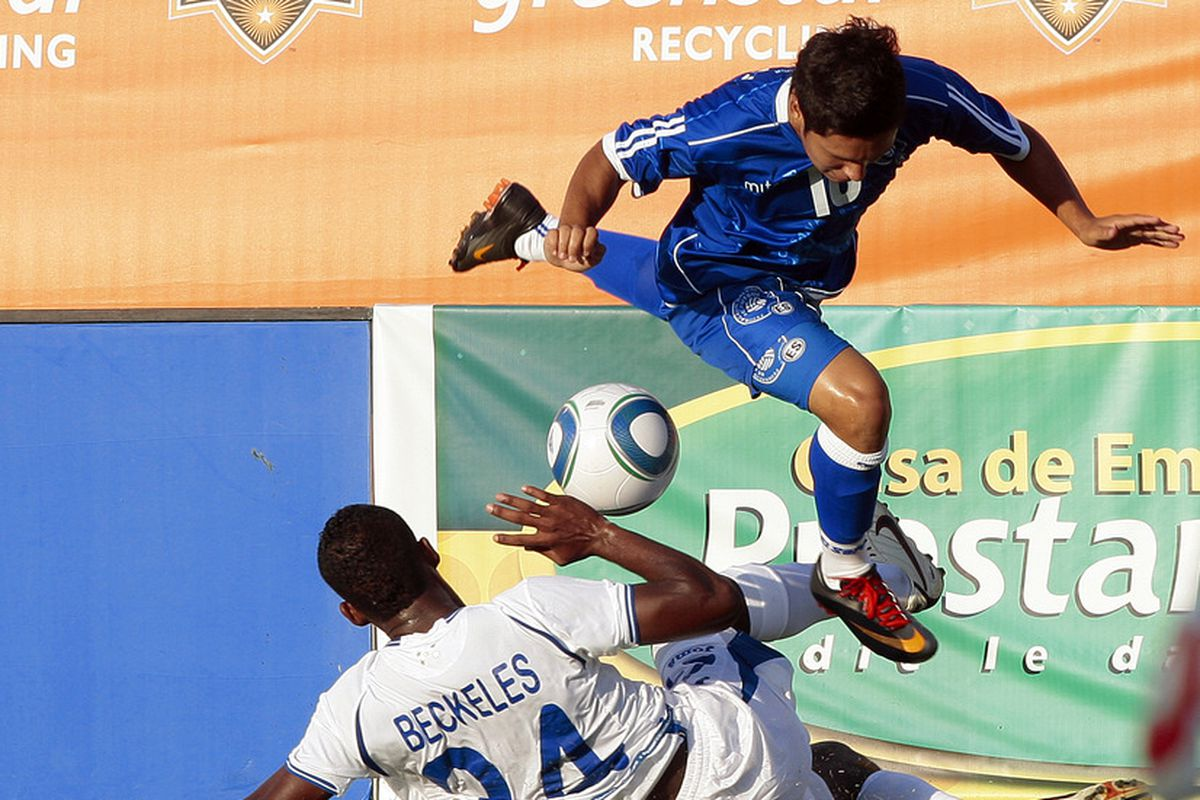 Salvadoran international Jaime Alas avoids a tackle during a friendly prior to the start of the 2011 CONCACAF Gold Cup.