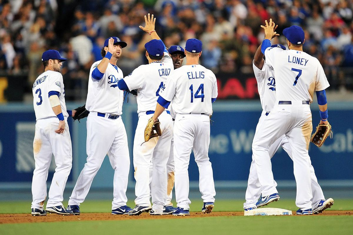 July 4, 2012; Los Angeles, CA, USA; Los Angeles Dodgers celebrate their 4-1 victory against the Cincinnati Reds at Dodger Stadium. Mandatory Credit: Gary A. Vasquez-US PRESSWIRE
