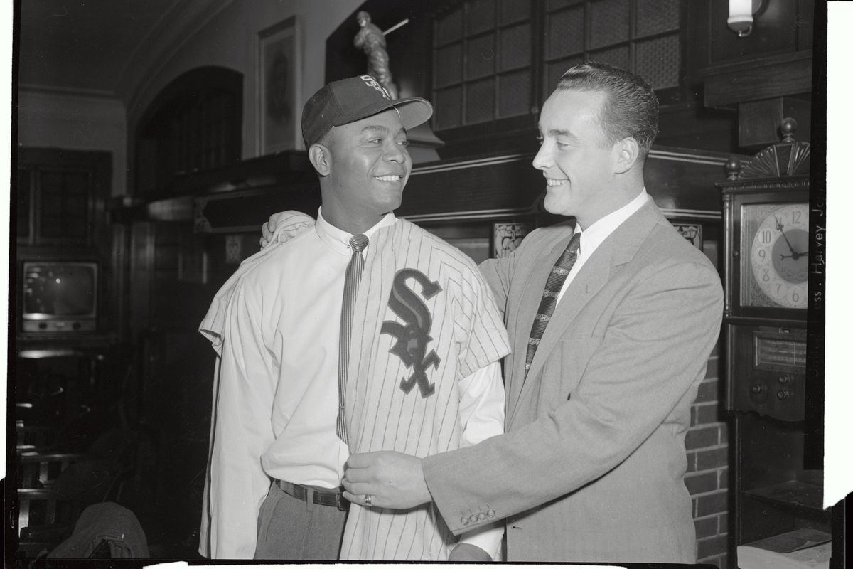 Larry Dolby Being Fitted in His Baseball Uniform