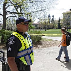 Boulder County Sheriff Sgt. Jeff Goetz stands watch at the Norlin Quad at the University of Colorado in Boulder, Colo., on Friday, April 20, 2012. The university closed the area and the campus to prohibit an annual 420 marijuana smoke out.