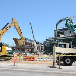 11:54 a.m. Excavating machine working just inside the Clark Street fence -