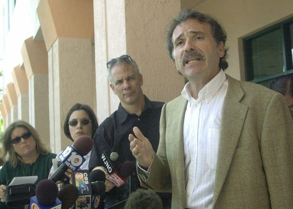 American Media Inc. chairman and CEO David Pecker, right, outside the company's headquarters in Boca Raton, Fla.   AP file photo