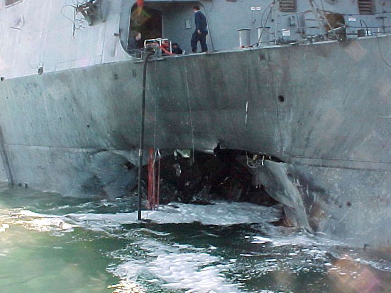A gaping hole mars the port side of USS Cole after a terrorist bomb exploded and killed 17 US sailors and injured 39 others on October 12, 2000, in Aden, Yemen.