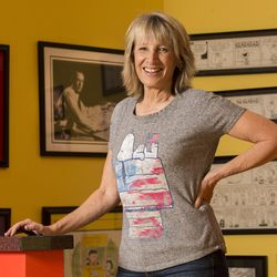 Amy Schulz Johnson, daughter of Peanuts' creator Charles Schulz, poses for photos as she talks about her father at her Alpine home Wednesday, Oct. 28, 2015.