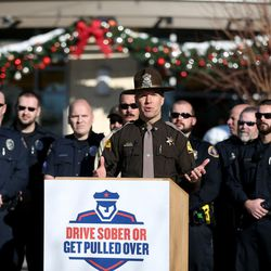 Utah Highway Patrol Col. Daniel Fuhr speaks at a launch of a new Holiday DUI-prevention effort between the Utah Highway Safety Office, Utah Highway Patrol, local law enforcement, the Utah Department of Alcoholic Beverage Control and singer songwriters (David Osmond and Carmen Rasmusen Herbert) at Fashion Place Mall in Murray on Friday, Dec. 18, 2015.