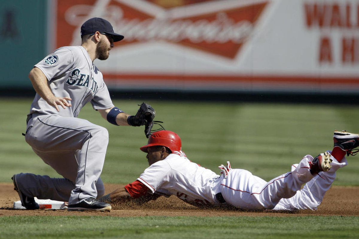 Los Angeles Angels' Erick Aybar steals second ahead of the tag by Seattle Mariners second baseman Dustin Ackley during the second inning of a baseball game in Anaheim, Calif., Thursday, Sept. 27, 2012.