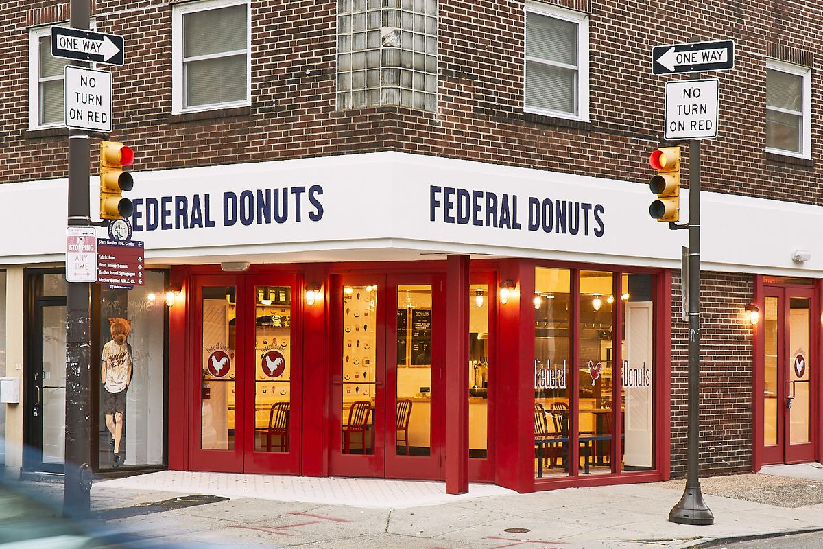 corner storefront with sign that says federal donuts