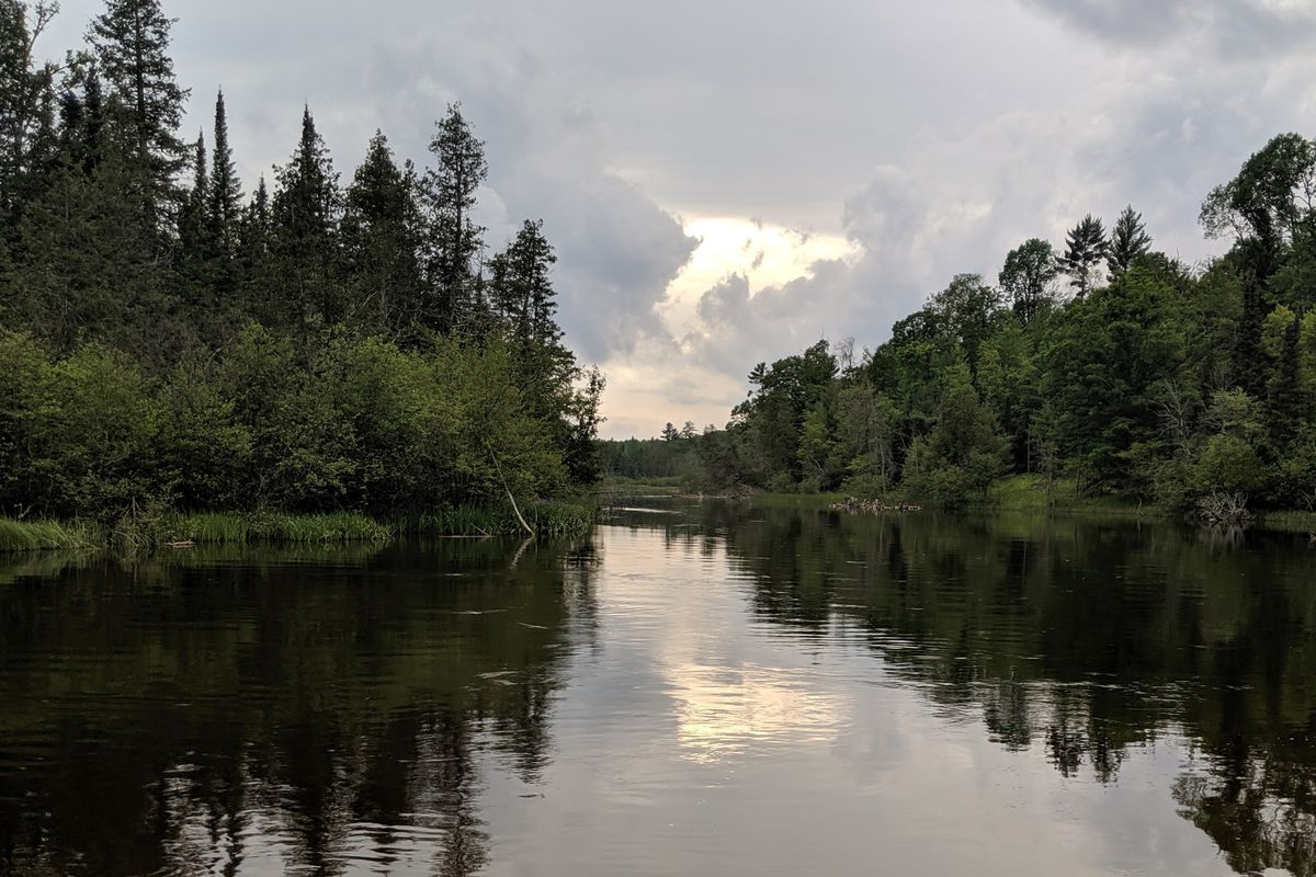 Exploring the magic and history of night fishing for big brown trout on the Au Sable River during the Hex hat…