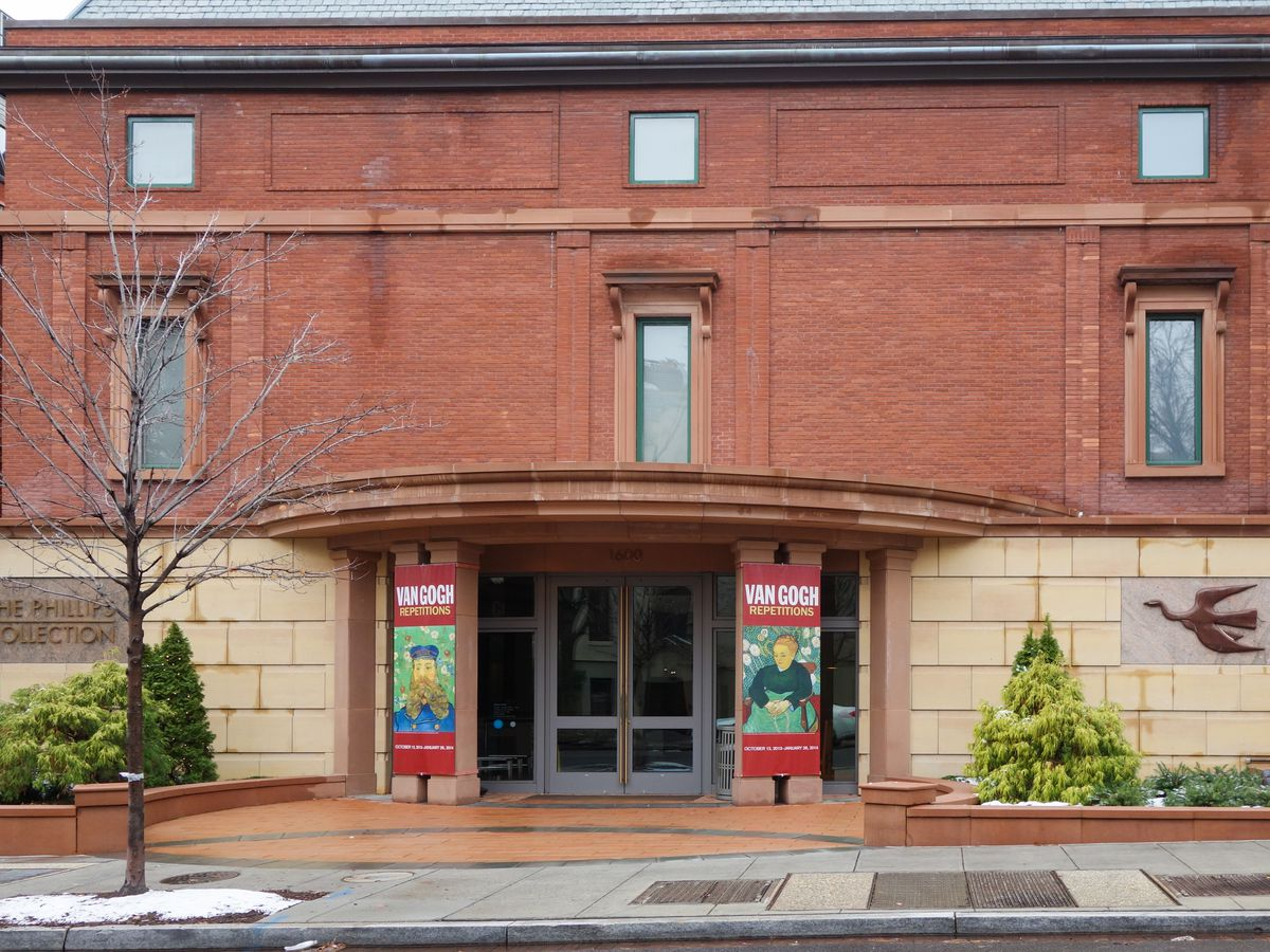 The exterior of the Phillips Collection in Washington D.C. The facade is red brick with a circular awning over the entrance area.