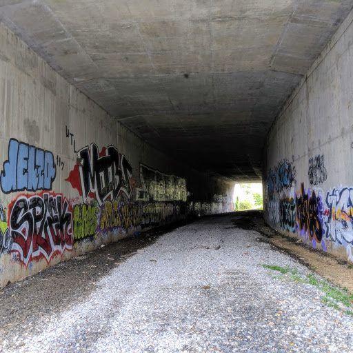 A graffiti-strewn tunnel beneath and interstate in Atlanta.