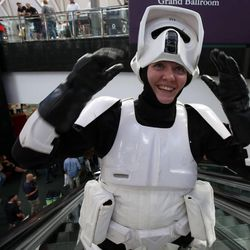 Brittanie Larsen, dressed as a stormtrooper from Star Wars, rides the escalator at Utah's first Comic Con at the Salt Palace Convention Center in Salt Lake City on Thursday, Sept. 5, 2013.