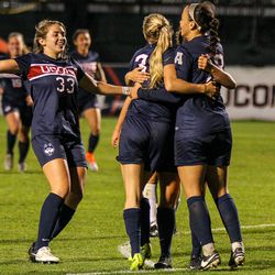 UConn women's soccer celebrates Rachel Hill's goal.
