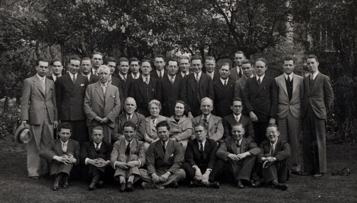 Joseph F. Merrill and Gordon B. Hinckley with a group of missionaries in England.
