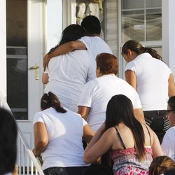 Family and friends of Riccardo Portillo walk back into the family's home following a press conference Sunday, May 5, 2013 at the Portillo home. Portillo died Saturday, May 4 from injuries sustained from being hit by a 17-year-old soccer player. Funeral services will be Wednesday.