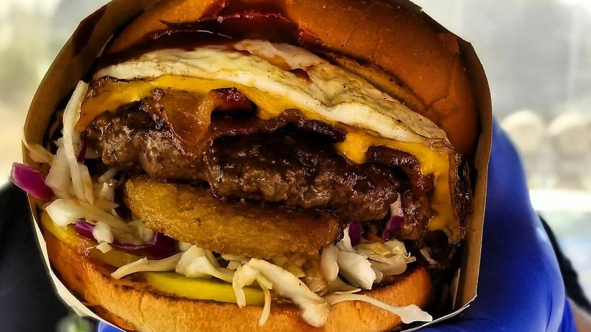 Da Breakfast Burger from El Chino Grande features a teriyaki-glazed patty, fried egg, hashbrown, bacon, and cabbage slaw.