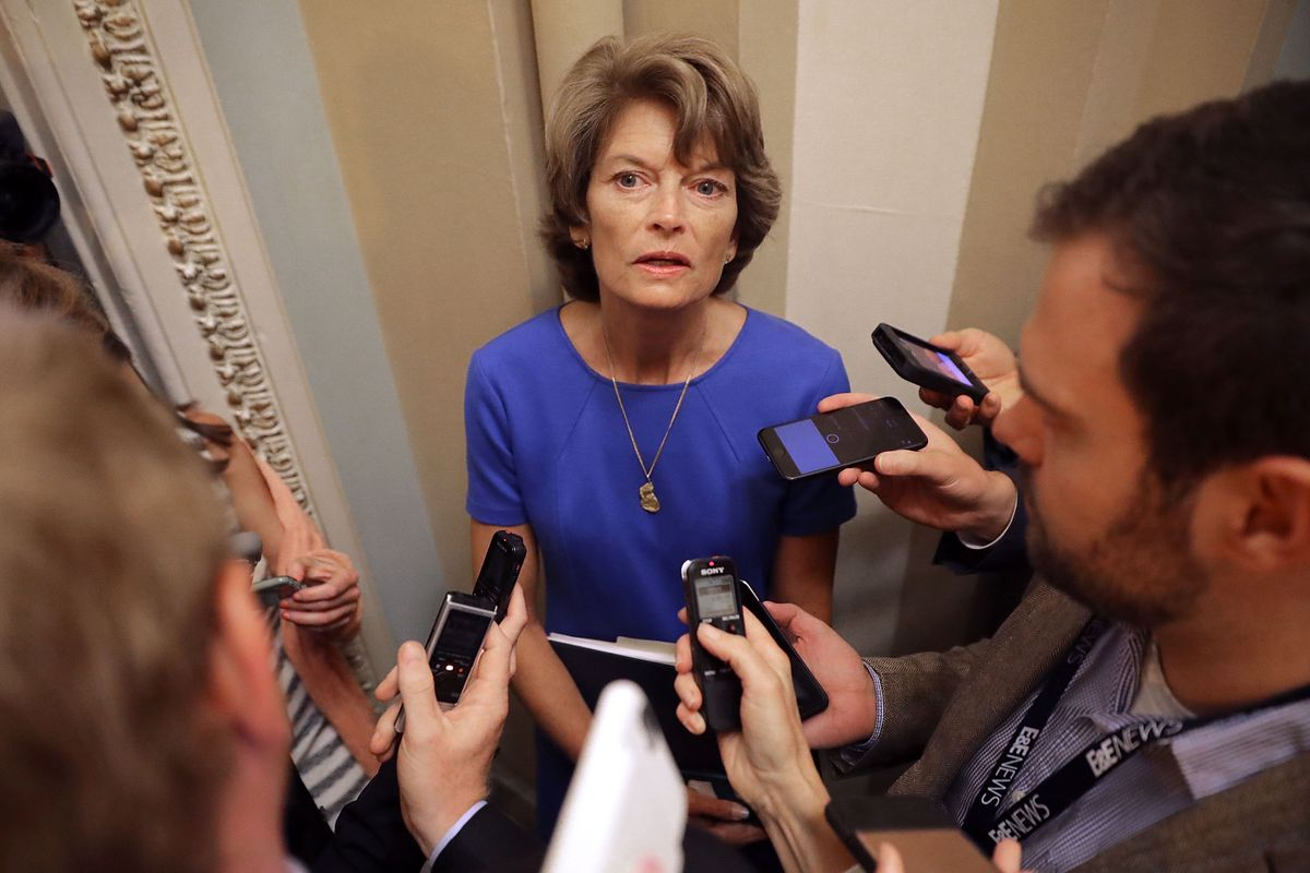 WASHINGTON, DC - JULY 18:  Sen. Lisa Murkowski (R-AK) talks with reporters before attending the weekly Senate Republican policy luncheon outside the Mansfield Room at the U.S. Capitol July 18, 2017 in Washington, DC. Senate Majority Leader Mitch McConnell