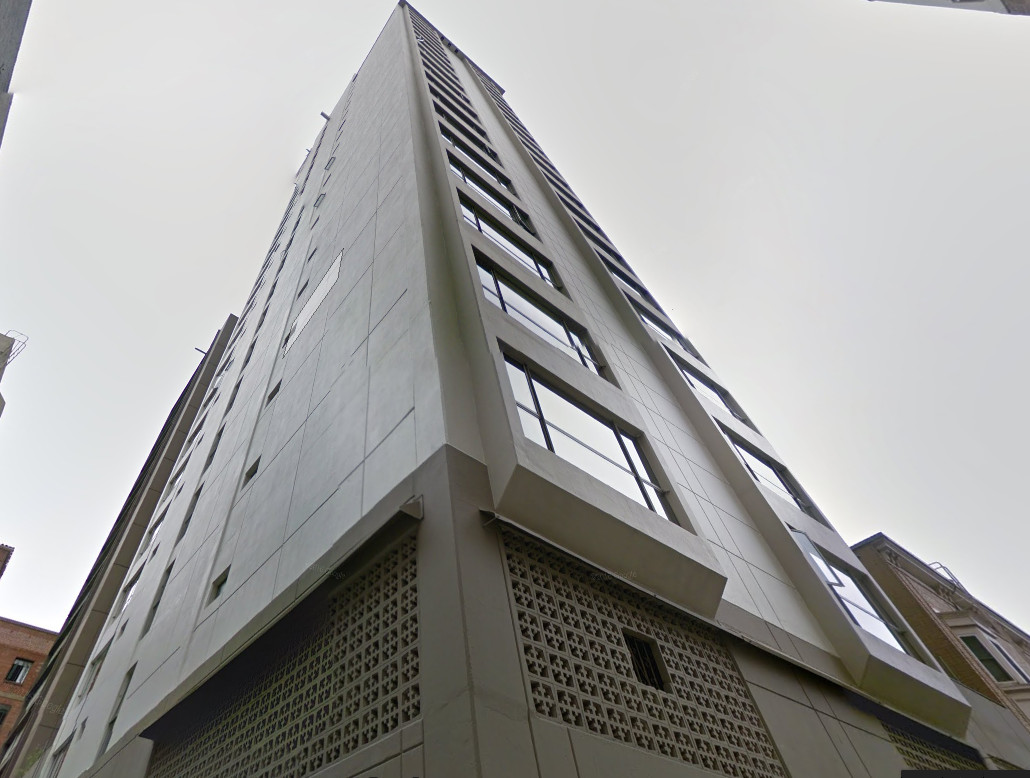 10 Miller Place from below. Tall, gray high-rise.
