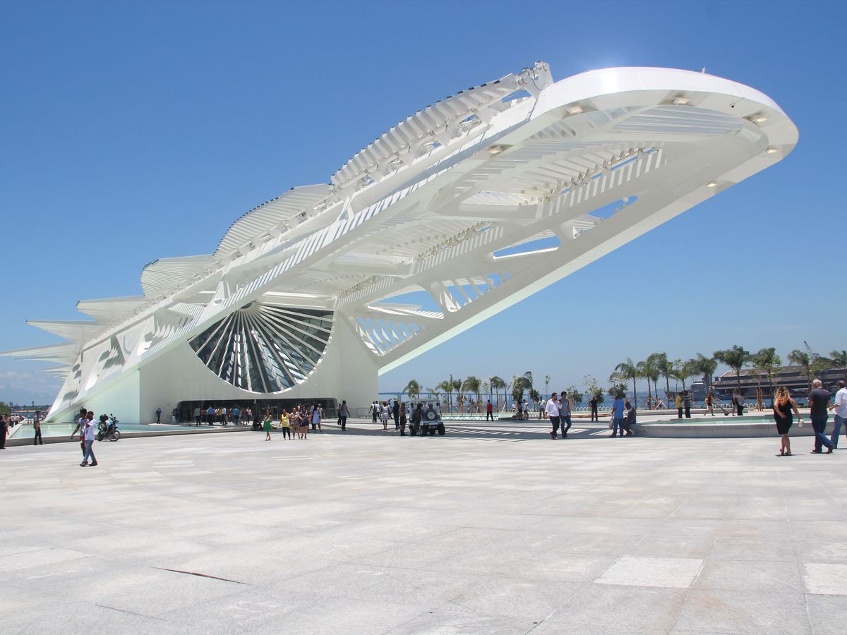 The exterior of the Museum of Tomorrow in Rio de Janeiro, Brazil. The facade is white with a sloped design.