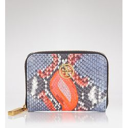"""<b>Tory Burch</b> Coin Case in violet snake, <a href=""""http://www1.bloomingdales.com/shop/product/tory-burch-coin-case-violet-neon-snake?ID=662900&CategoryID=1000417&LinkType=#fn%3Dspp%3D3"""">$125</a> at Bloomingdale's"""