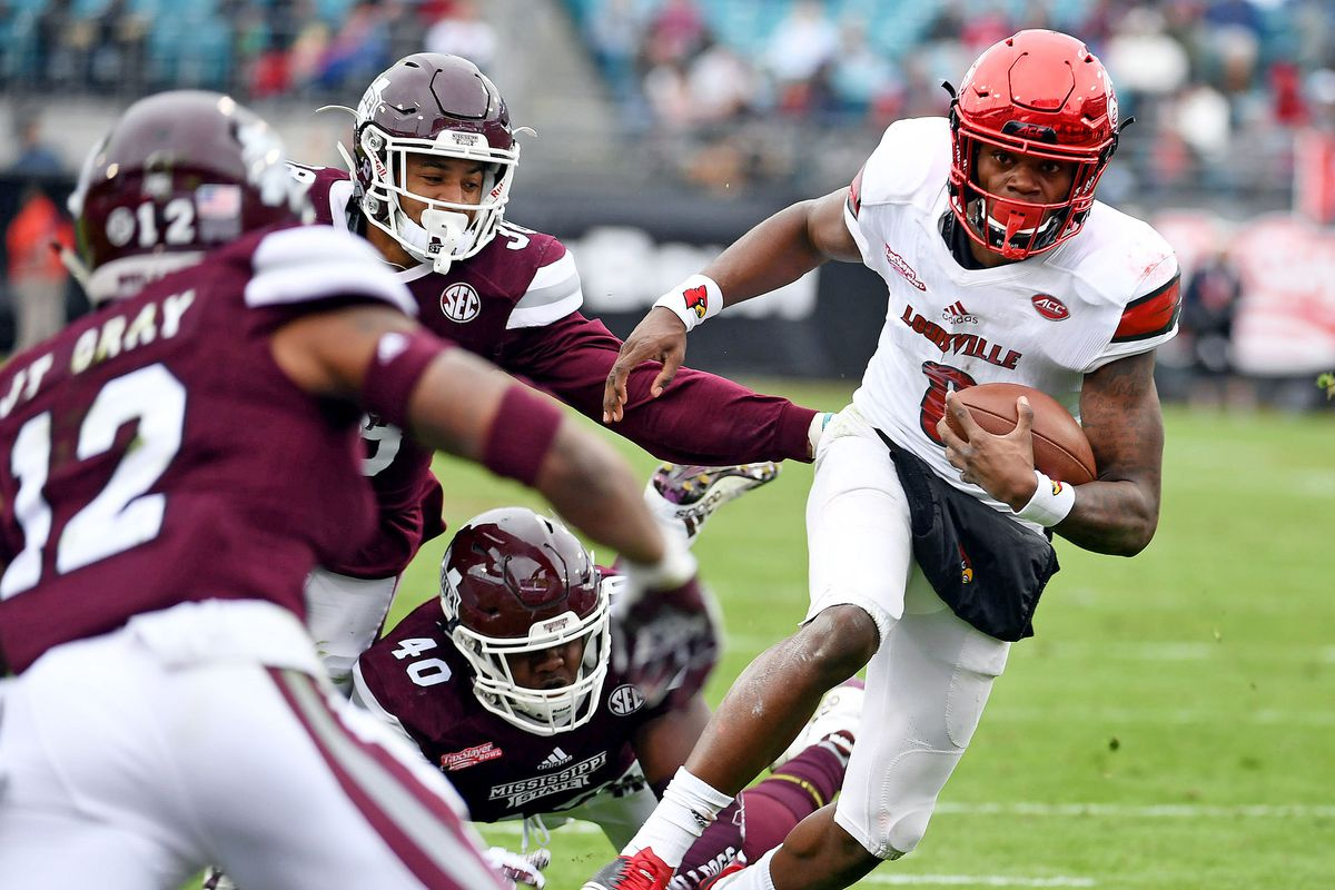 JACKSONVILLE, FL - Louisville Cardinals quarterback Lamar Jackson (8) runs for a touchdown during the first half  against the Mississippi State Bulldogs in the 2017 TaxSlayer Bowl at  EverBank Field.