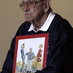 """Butch Corbett of Bennington, Vt., poses with a1950 Saturday Evening Post cover illustration """"The Toss"""" by Norman Rockwell for which he modeled at the Bennington Museum on Friday, Sept. 28, 2012, in Bennington, Vt. Corbett is the player on the left."""