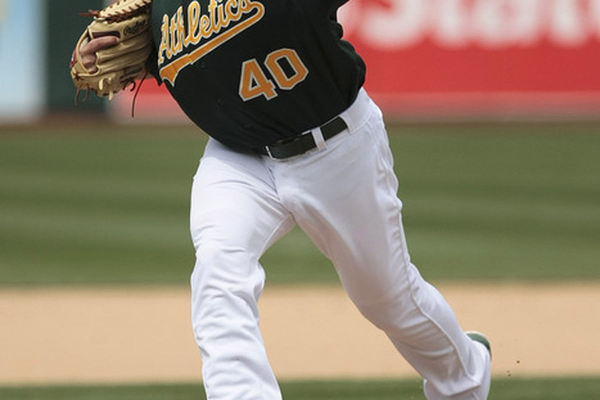 April 11, 2012; Oakland, CA, USA; Oakland Athletics relief pitcher Brian Fuentes (40) pitches the ball against the Kansas City Royals during the seventh inning at O.co Coliseum. Mandatory Credit: Kelley L Cox-US PRESSWIRE