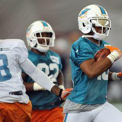 Jun 11, 2013; Davie, FL, USA; Miami Dolphins wide receiver Brandon Gibson (10) runs during practice drills at the Doctors Hospital Training Facility at Nova Southeastern University.