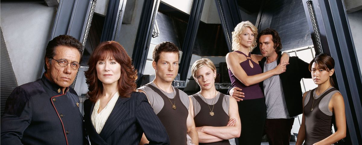 The core cast of 2004's Battlestar Galactica pose together