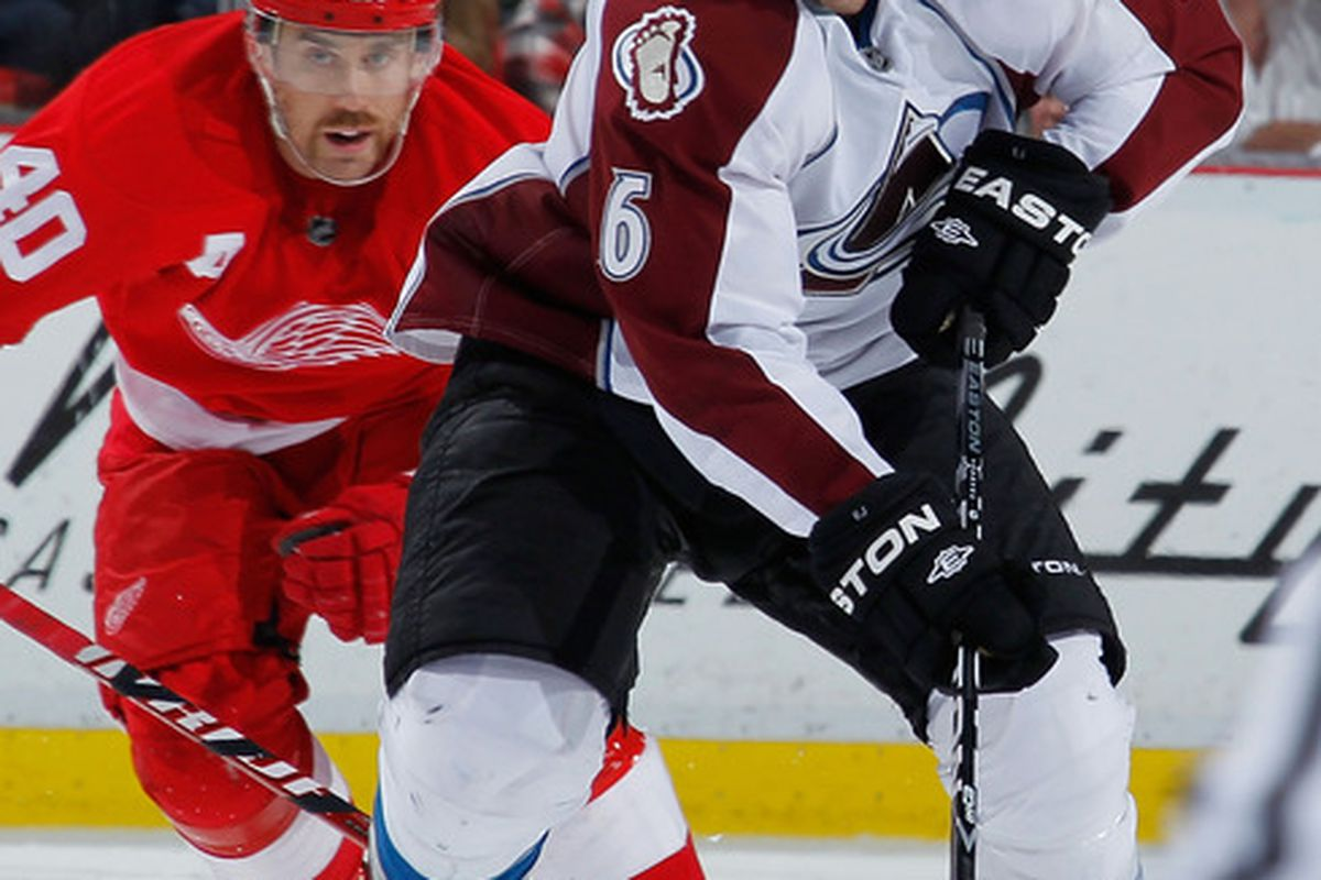 Erik Johnson, seen wearing the appropriate facial expression for when a man with a moustache like that approaches you from behind.