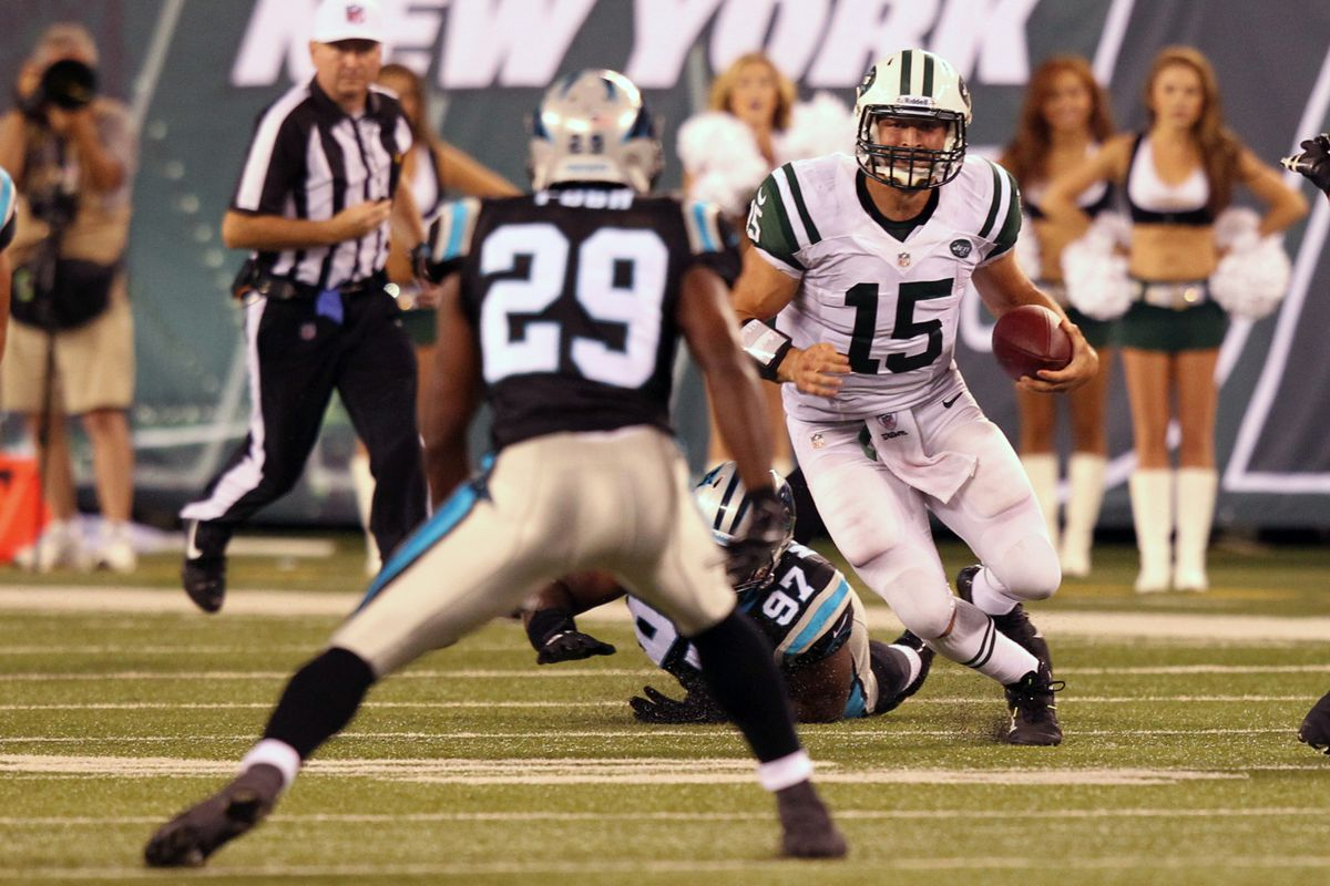 Aug 26, 2012; East Rutherford, NJ,  New York Jets quarterback Tim Tebow (15) carries during the fourth quarter against the Carolina Panthers at Met Life Stadium.  Panthers won 17-12. Anthony Gruppuso-US PRESSWIRE