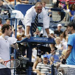 Britain's Andy Murray, left, and Czech Republic's Tomas Berdych, right, talk with the umpire about a call during a semifinal match at the 2012 US Open tennis tournament,  Saturday, Sept. 8, 2012, in New York.